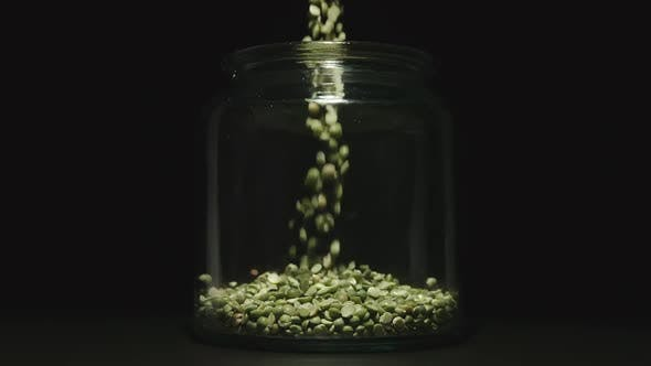 Thumbnail for Green Peas Pouring Into A Glass Jar