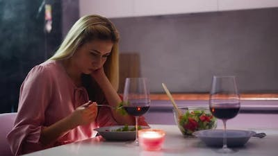 Sad Woman Picks at Food Suffering From Unsuccessful Date