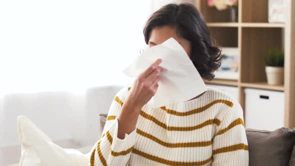 Cover Image for Sick Woman Blowing Nose in Paper Tissue at Home 1