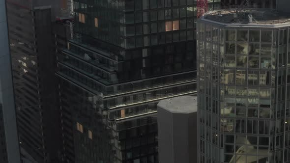 Thumbnail for AERIAL: Close Up View of Skyscraper Construction Site in Urban Environment with City Car Traffic and