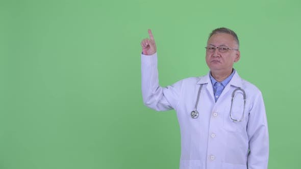 Thumbnail for Stressed Mature Japanese Man Doctor Pointing Up
