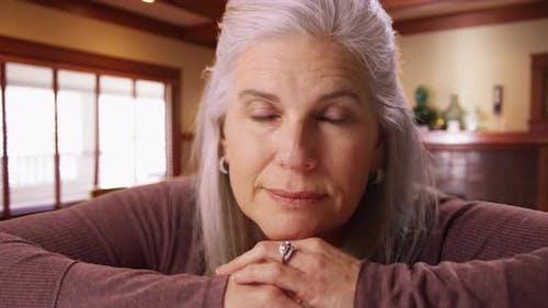 Beautiful Caucasian senior woman looking at camera