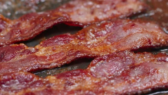 Cover Image for Fry bacon in pan in kitchen for breakfast