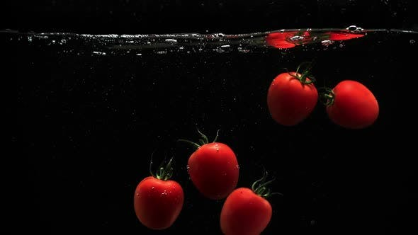 Thumbnail for Red Ripe Tomatoes Under Water With Lot Of Air Bubbles Black Background