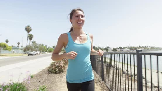 Thumbnail for Woman running on path smiling