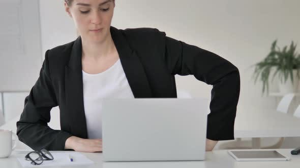 Cover Image for Young Businesswoman Leaving Office