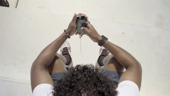 Thumbnail for Top View of African American Man Using Modern Phone Outdoor