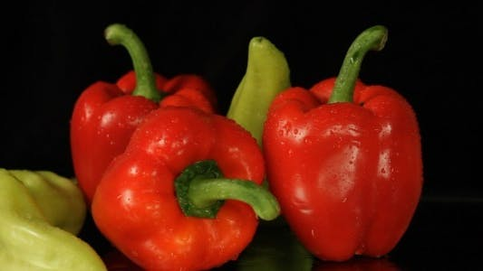 Thumbnail for Red And Green Peppers Rotating On Black
