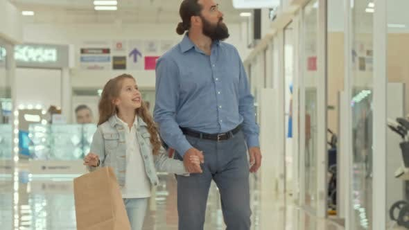 Thumbnail for Loving Father Walking at Shopping Mall with His Adorable Little Daughter