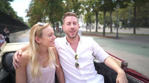 Tourist Couple in Carriage