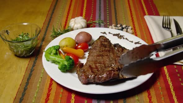 Thumbnail for A Porterhouse Or T-bone Steak Served With Vegetables 46