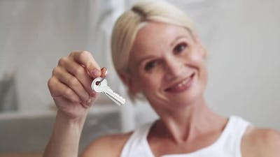 Real Estate House Mortgage Happy Mature Woman Key