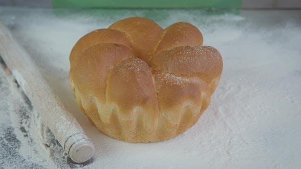 Sprinkle Bread with Flour.