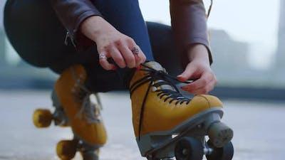 Unknown Roller Skater Preparing to Workout
