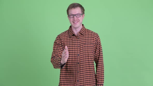 Thumbnail for Happy Young Hipster Man Giving Handshake