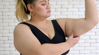 Portrait of an unhappy overweight woman in sportswear