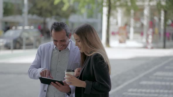 Cover Image for Happy Colleagues Using Tablet Pc Outdoor