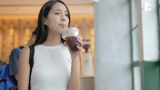 Thumbnail for Woman enjoy coffee and using cellphone at cafe