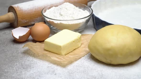 Cover Image for Unrolled and Unbaked Shortcrust Pastry Dough Recipe on Wooden Background