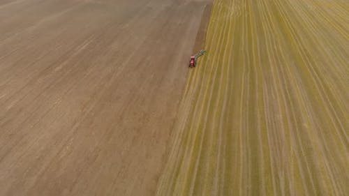 Aerial Tractor Plowing the Stubble Cover a Wide Swath