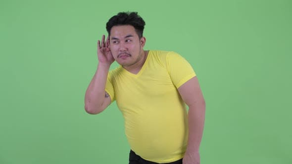 Thumbnail for Happy Young Overweight Asian Man Listening