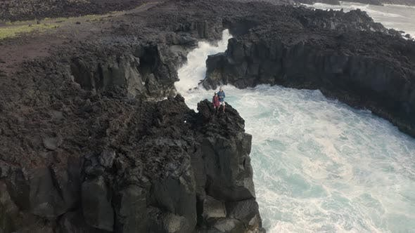 Aerial view of couple on coastal cliffs