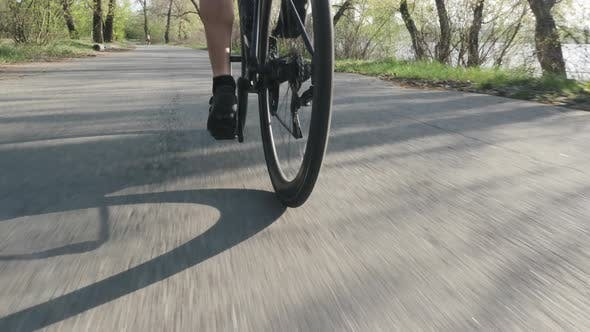 Thumbnail for Cyclist Pedaling on Road Bicycle