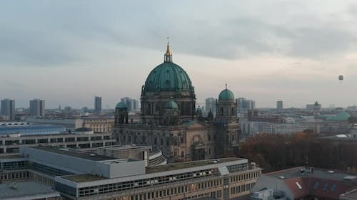 AERIAL: Over Rooftops of Berlin, Germany City Center in Fall Colors Towards Berlin Cathedral at