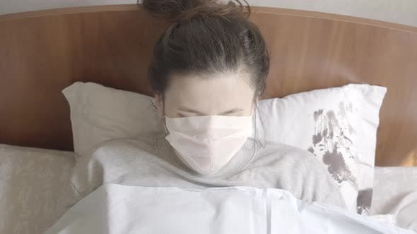 Top View of Young Ill Woman Sneezing and Coughing