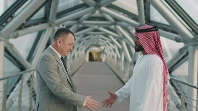 Arab And Asian Business Partners Shaking Hands