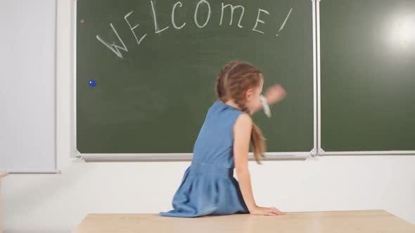 Back To School Concept. Schoolgirl Chalkboard in Classroom.