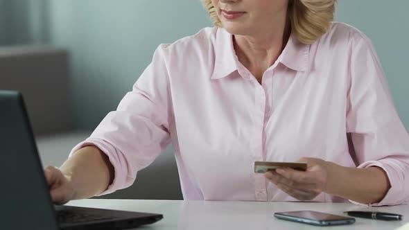 Thumbnail for Mature Female Inserting Card Number on Laptop, Shopping Online, Close-Up