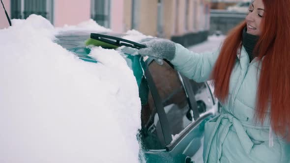 Thumbnail for Joyful Woman Cleans Snow From Her Car
