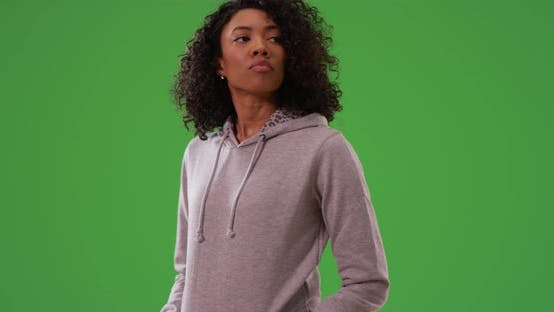 Thumbnail for Black woman waiting and looking around while dancing by herself on greenscreen