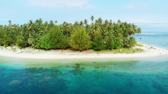 Aerial: flying over desert tropical island in Indonesia
