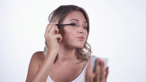 Thumbnail for Woman Applying Black Mascara