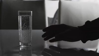 A Man Raises A Glass Of Water To Drink, Mineral Water In A Glass, A Man Drinks Water.