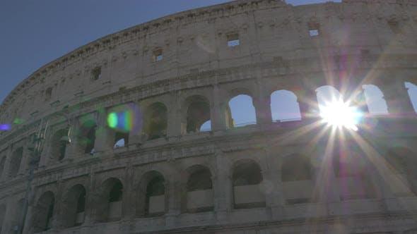 Roman Coliseum ruins in bright sunrays