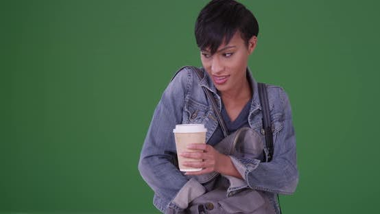 Thumbnail for Black woman pulling smartphone out of purse on green screen