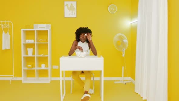 Thumbnail for Woman Is Playing With Marshmallow In Yellow Room