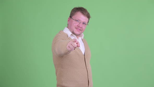 Cover Image for Happy Overweight Bearded Man Pointing at Camera