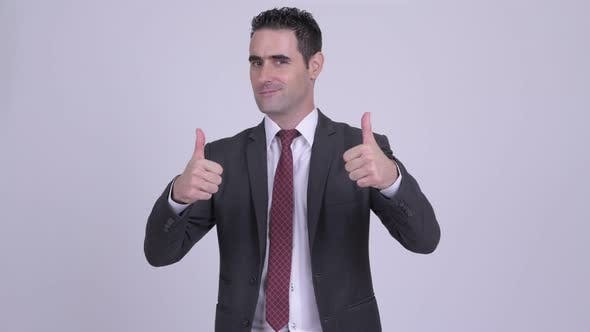 Thumbnail for Happy Handsome Businessman Giving Two Thumbs Up