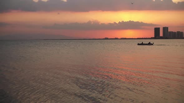 Thumbnail for Inflatable Boat Rides At Sunset