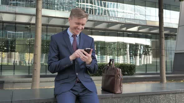 Thumbnail for Happy Businessman Using Smartphone for Reading Email