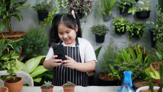 Girl take a photo plant