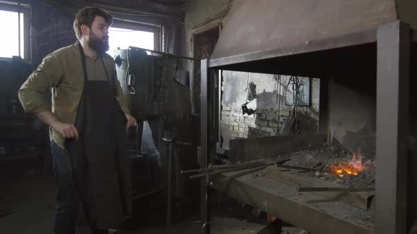 Cover Image for Blacksmith Beginning His Working Day in Workshop