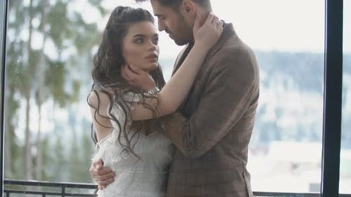 Couple Cuddling on the Balcony