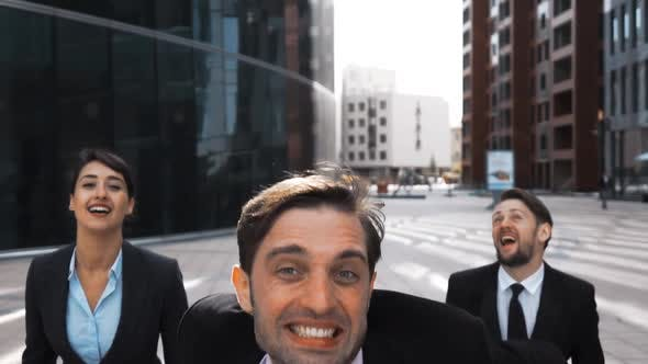 Thumbnail for Businesswoman and Two Businessman Exult and Jump with Happiness