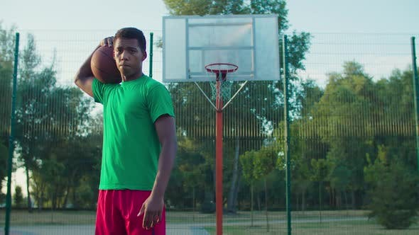 Thumbnail for Street Basketball Player on Outdoor Court at Dawn