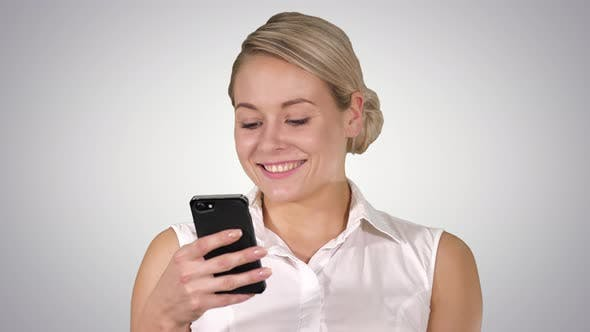 Thumbnail for Happy Young Beautiful Woman Smiling and Using Mobile Phone